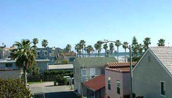 Oceanside Beach Rental, view inside to pier from living area and bedroom, click to enlarge