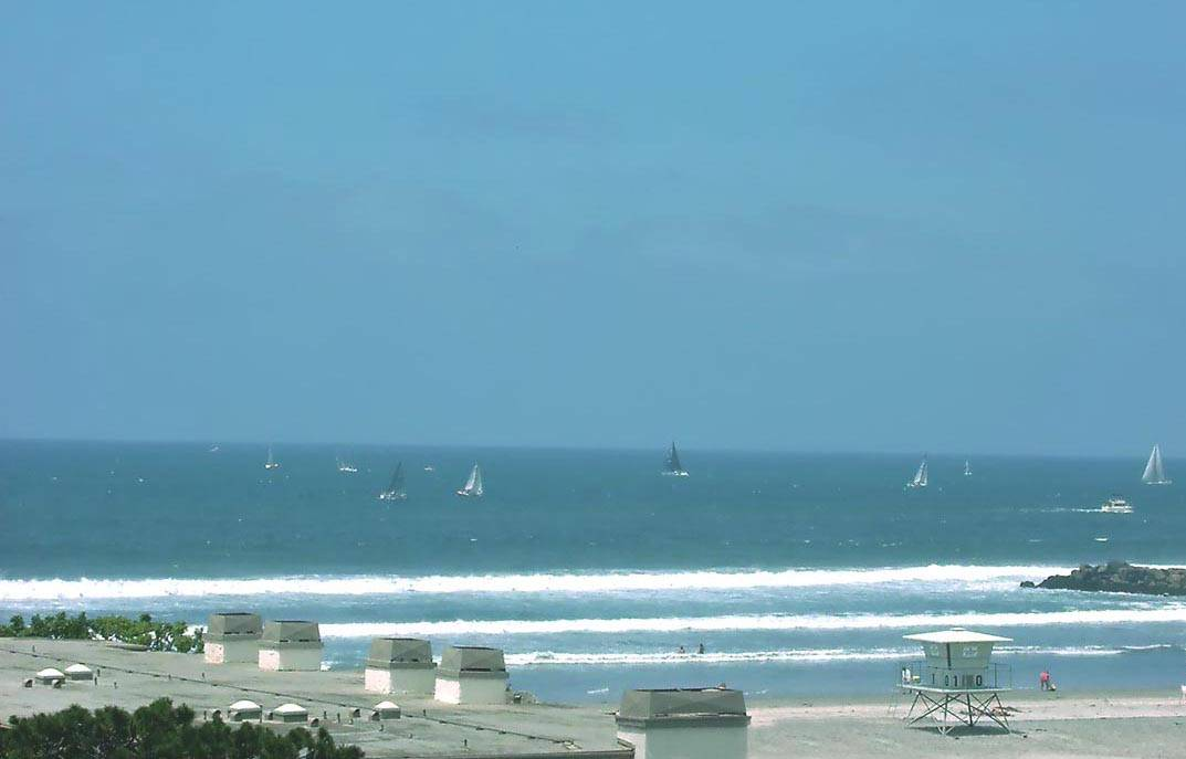 Oceanside California vacation condo for rent at Franks Beach Condos, North Coast Village; view from inside our 2 bedroom beach facing corner condo, click to enlarge