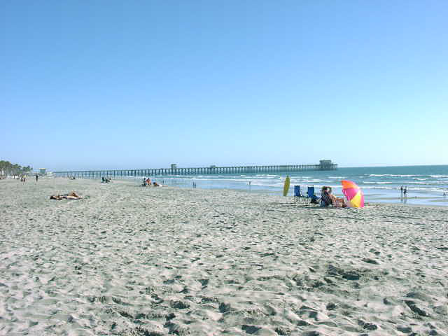 Oceanside California vacation beach rental at North Coast Village; this beach is the beach closest to the one bedroom condo up near the sand and the cottage condo on The Strand. Click to enlarge.